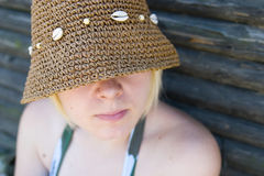 Woman with sun hat Stock Images