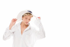 Woman with a sun hat looking down Royalty Free Stock Photography