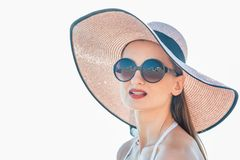Woman with sun hat standing at the beach Royalty Free Stock Photography