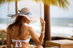 Woman with sun hat, summertime Stock Images
