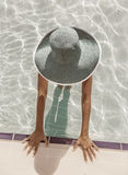 Woman in sun hat in the swimming pool. Top view. Stock Image