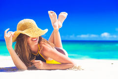 Woman in sun hat and swimsuit at beach. blowing a kiss Royalty Free Stock Photos