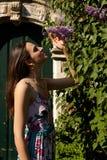 Woman sun lilac syringa wall door, Groot Begijnhof, Leuven, Belgium royalty free stock images