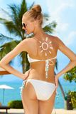 Woman with a sun painted on her back Royalty Free Stock Photo
