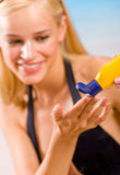 Woman with sun-protection cream Stock Images