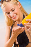 Woman with sun-protection cream Royalty Free Stock Photos