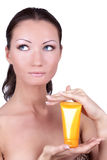 Woman with sun protection cream in her Stock Image