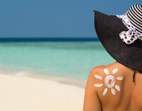Woman with sun-shaped sun cream Stock Photo