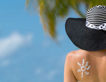 Woman with sun-shaped sun cream Royalty Free Stock Photo