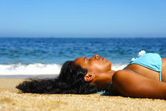 Woman Sun Tanning Stock Photos