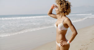 Woman During Sunbath On Tropical Beach Royalty Free Stock Photography