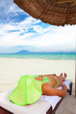Woman sunbathing Stock Image