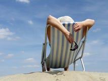 Woman sunbathing on the beach Stock Photos