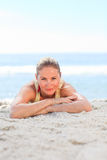 A woman sunbathing at the beach Stock Image