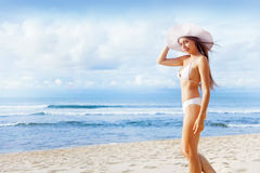 Woman sunbathing on a beach Stock Images
