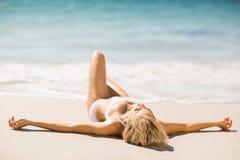 Woman sunbathing on beach Royalty Free Stock Photos