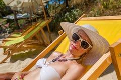 Woman sunbathing on the beach Royalty Free Stock Image