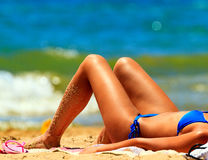 Woman sunbathing on a beach Royalty Free Stock Images