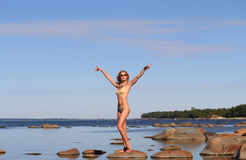 Woman on the beach. Woman sunbathing on the beach, summer time Royalty Free Stock Images