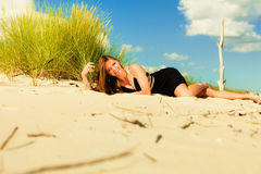 Woman sunbathing on beach. Royalty Free Stock Images