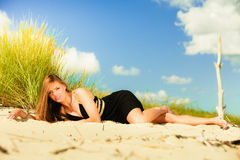 Woman sunbathing on beach. Royalty Free Stock Image