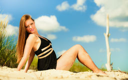 Woman sunbathing on beach. Royalty Free Stock Image