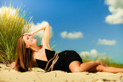 Woman sunbathing on beach. Royalty Free Stock Photos