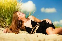 Woman sunbathing on beach. Royalty Free Stock Photos