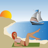 Woman sunbathing on the beach Royalty Free Stock Image