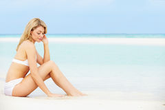 Woman Sunbathing On Beautiful Beach Holiday Royalty Free Stock Images