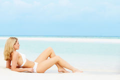 Woman Sunbathing On Beautiful Beach Holiday Stock Photo