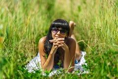 Woman sunbathing in bikini Royalty Free Stock Image