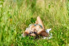 Woman sunbathing in bikini Stock Images