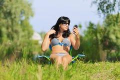 Woman sunbathing in bikini Stock Photos