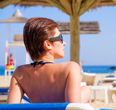 Woman sunbathing in bikini at resort Royalty Free Stock Photography