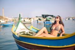 Woman sunbathing. In a boat Royalty Free Stock Photo