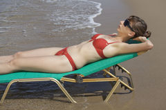 Woman sunbathing in chair Royalty Free Stock Photo