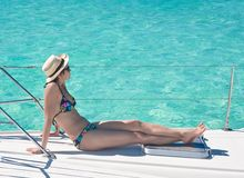 Woman sunbathing on the deck Royalty Free Stock Images