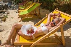 Woman sunbathing on deck Royalty Free Stock Photography