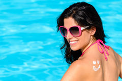 Woman sunbathing and enjoying summer with sunscreen Royalty Free Stock Photos