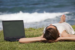 Woman sunbathing on grass Royalty Free Stock Photo