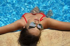 Woman Sunbathing In Swimming Pool Royalty Free Stock Images