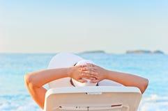Woman sunbathing on a lounger Stock Photo