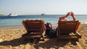 Woman Sunbathing on a Lounger Overlooking the Red Sea stock video