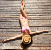 Woman sunbathing lying at deck Royalty Free Stock Images