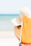 Woman sunbathing and relaxing on beach. Royalty Free Stock Images