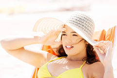 Woman sunbathing and relaxing on beach. Royalty Free Stock Image