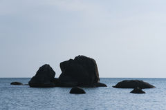 Woman sunbathing on coastal rock koh samui Royalty Free Stock Photography