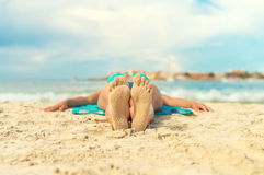 Woman sunbathing on sand. Place for text Stock Photos