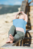 Woman sunbathing at the sea Stock Images